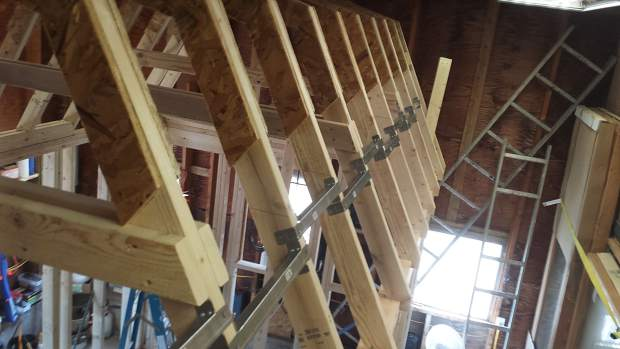 Trusses going up in the tiny home built by Bruce Hoffman and Randy Glassman