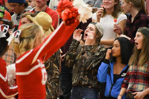 The Glenwood Springs student section yells and cheer during the rival game against the Rifle Bears on Thursday night at Glenwood Springs High School.
