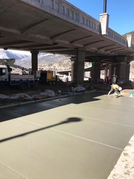 Crews made some serious progress Monday in pouring the concrete slabs along the east side of the new Grand Avenue bridge in downtown Glenwood Springs. Work is expected to continue beneath the bridge in the 700 block of Grand for a few more weeks, in hopes of an early spring reopening of the under-bridge pedestrian walkway.