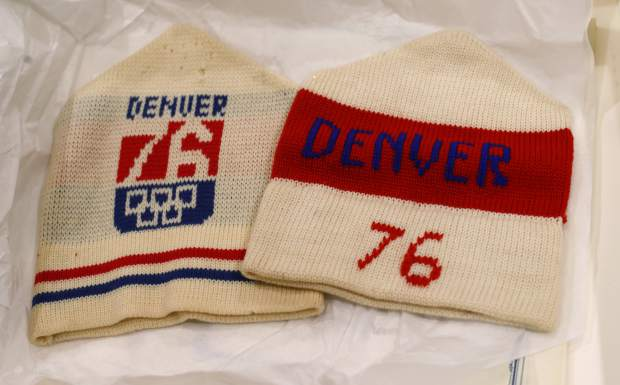 In this Feb. 1, 2018, photo, stocking hats used in Colorado's effort to secure an Olympic bid in 1976 are part of the memorabilia collection of the Denver Public Library in Denver. Over 40 years after becoming the first city to walk away from an Olympic bid, Denver is considering whether to try to again to host the Winter Games. (AP Photo/David Zalubowski)