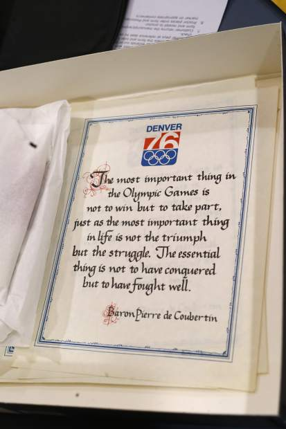 In this Feb. 1, 2018, photo, a proclamation used in Colorado's effort to secure an Olympic bid in 1976 is part of the memorabilia collection of the Denver Public Library in Denver. Over 40 years after becoming the first city to walk away from an Olympic bid, Denver is considering whether to try to again to host the Winter Games. (AP Photo/David Zalubowski)