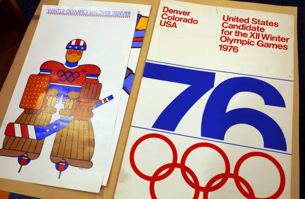 In this Feb. 1, 2018, photograph, one of the posters used in Colorado's effort to secure an Olympic bid in 1976 is part of the memorabilia collection of the Denver Public Library in Denver. Over 40 years after becoming the first city to walk away from an Olympic bid, Denver is considering whether to try to again to host the Winter Games. (AP Photo/David Zalubowski)