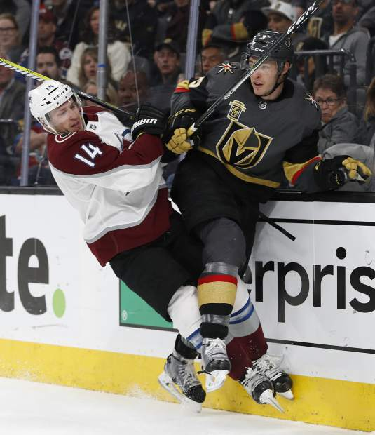 Colorado Avalanche left wing Blake Comeau (14) checks Vegas Golden Knights defenseman Brayden McNabb (3) during the second period of an NHL hockey game, Monday, March 26, 2018, in Las Vegas. (AP Photo/John Locher)