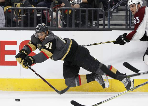 Vegas Golden Knights left wing Pierre-Edouard Bellemare (41) passes around Colorado Avalanche left wing Matt Nieto (83) during the first period of an NHL hockey game, Monday, March 26, 2018, in Las Vegas. (AP Photo/John Locher)