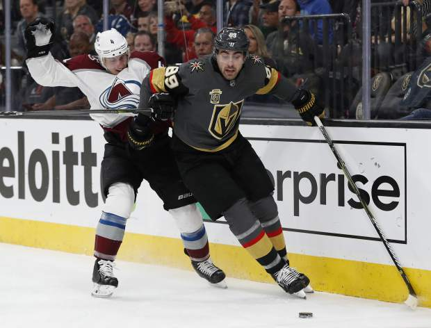 Vegas Golden Knights right wing Alex Tuch (89) skates around Colorado Avalanche defenseman Tyson Barrie (4) during the first period of an NHL hockey game, Monday, March 26, 2018, in Las Vegas. (AP Photo/John Locher)