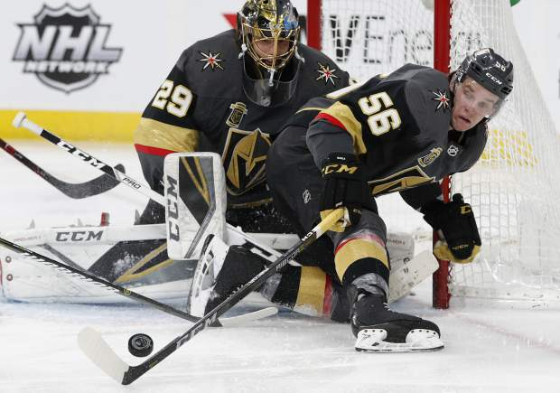 Vegas Golden Knights left wing Erik Haula knocks the puck away from goaltender Marc-Andre Fleury during the second period of an NHL hockey game against the Colorado Avalanche, Monday, March 26, 2018, in Las Vegas. (AP Photo/John Locher)