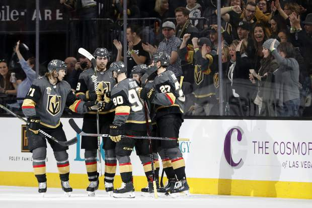 Vegas Golden Knights celebrate after scoring against the Colorado Avalanche during the second period of an NHL hockey game, Monday, March 26, 2018, in Las Vegas. (AP Photo/John Locher)