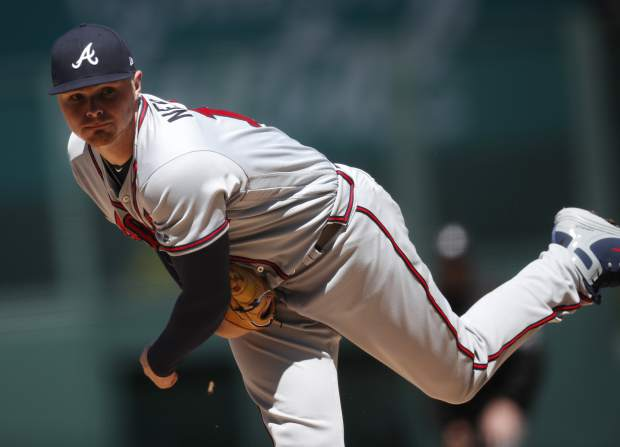 Atlanta Braves starting pitcher Sean Newcomb delivers a pitch to Colorado Rockies' Chris Iannetta in the first inning of a baseball game Sunday, April 8, 2018, in Denver. (AP Photo/David Zalubowski)