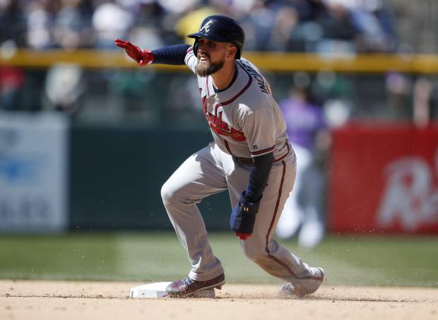 Atlanta Braves' Ender Inciarte steals second base against the Colorado Rockies in the fifth inning of a baseball game Sunday, April 8, 2018, in Denver. (AP Photo/David Zalubowski)