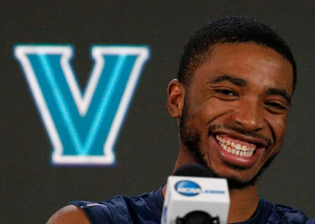 Villanova's Mikal Bridges laughs as he answers questions during a news conference for the championship game of the Final Four NCAA college basketball tournament, Sunday, April 1, 2018, in San Antonio. (AP Photo/Brynn Anderson)