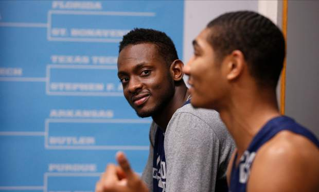 Villanova's Dhamir Cosby-Roundtree, left, watches Jermaine Samuels as Samuels answers questions during a news conference for the championship game of the Final Four NCAA college basketball tournament, Sunday, April 1, 2018, in San Antonio. (AP Photo/Brynn Anderson)