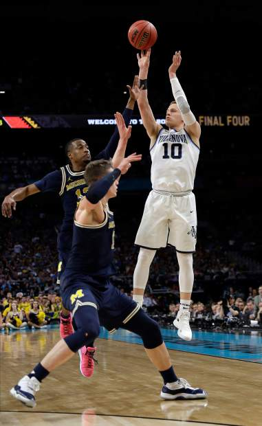 Villanova's Donte DiVincenzo (10) shoots a 3-point basket during the second half in the championship game of the Final Four NCAA college basketball tournament against Michigan, Monday, April 2, 2018, in San Antonio. (AP Photo/David J. Phillip)