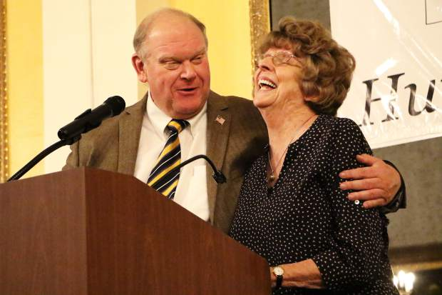 Marcie Wenzel won the Immeasurable Energy Award at the Garfield County Humanitarian Service Awards. County Commissioner Mike Samson offers congratulations.