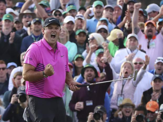 Patrick Reed celebrates after winning the Masters golf tournament Sunday, April 8, 2018, in Augusta, Ga. (Curtis Compton/Atlanta Journal-Constitution via AP)