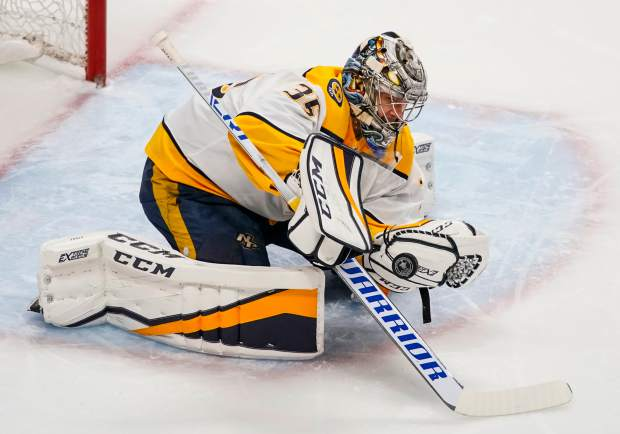 Nashville Predators goaltender Pekka Rinne makes a save against the Colorado Avalanche during the first period in Game 6 of an NHL hockey first-round playoff series Sunday, April 22, 2018, in Denver. (AP Photo/Jack Dempsey)