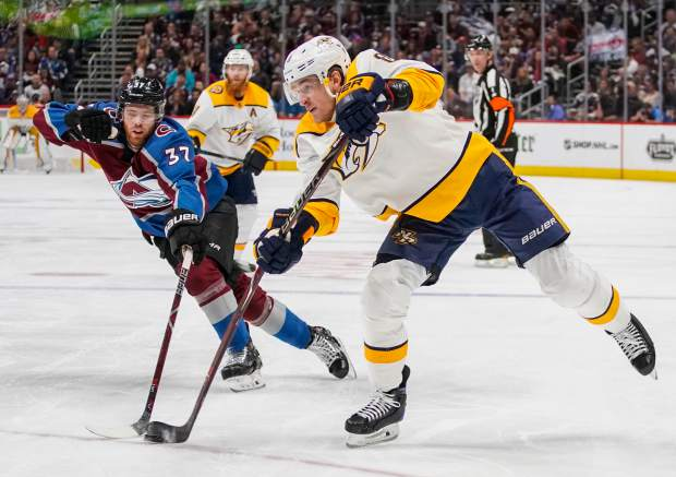 Nashville Predators center Kyle Turris (8) shoots against Colorado Avalanche left wing J.T. Compher (37) during the second period in Game 6 of an NHL hockey first-round playoff series Sunday, April 22, 2018, in Denver. (AP Photo/Jack Dempsey)