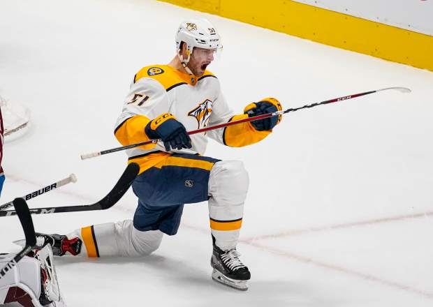 Nashville Predators left wing Austin Watson celebrates a goal against the Colorado Avalanche during the first period in Game 6 of an NHL hockey first-round playoff series Sunday, April 22, 2018, in Denver. (AP Photo/Jack Dempsey)