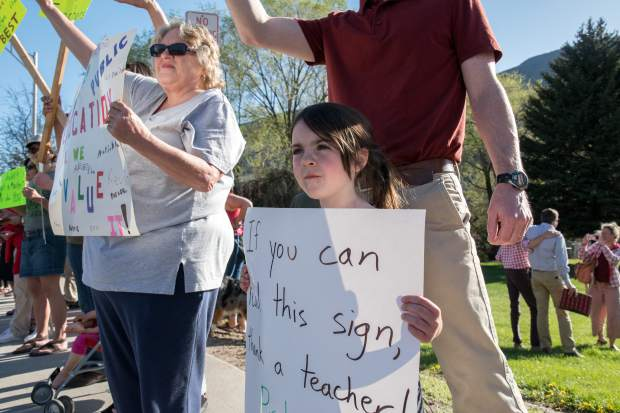 Five-year-old Sofia Norville rallies with parents, teachers and supporters in front of the district office in Glenwood Springs.