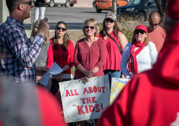 Crystal River Elementary School teacher Jennifer Carney (center) listens to speakers during the rally outside the district office in Glenwood Springs.