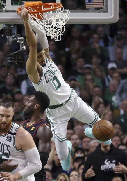 Boston Celtics forward Jayson Tatum (0) dunks over Cleveland Cavaliers forward Jeff Green during the first half in Game 7 of the NBA basketball Eastern Conference finals Sunday, May 27, 2018, in Boston. (AP Photo/Elise Amendola)