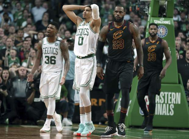 Boston Celtics guard Marcus Smart (36) and forward Jayson Tatum (0) react in front of Cleveland Cavaliers forward LeBron James during the second half in Game 7 of the NBA basketball Eastern Conference finals, Sunday, May 27, 2018, in Boston. (AP Photo/Elise Amendola)