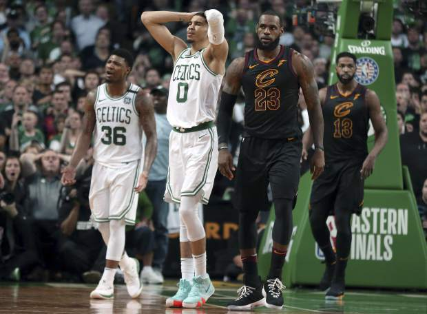 Boston Celtics guard Marcus Smart (36) and forward Jayson Tatum (0) react in front of Cleveland Cavaliers forward LeBron James (23) during the second half in Game 7 of the NBA basketball Eastern Conference finals, Sunday, May 27, 2018, in Boston. (AP Photo/Elise Amendola)