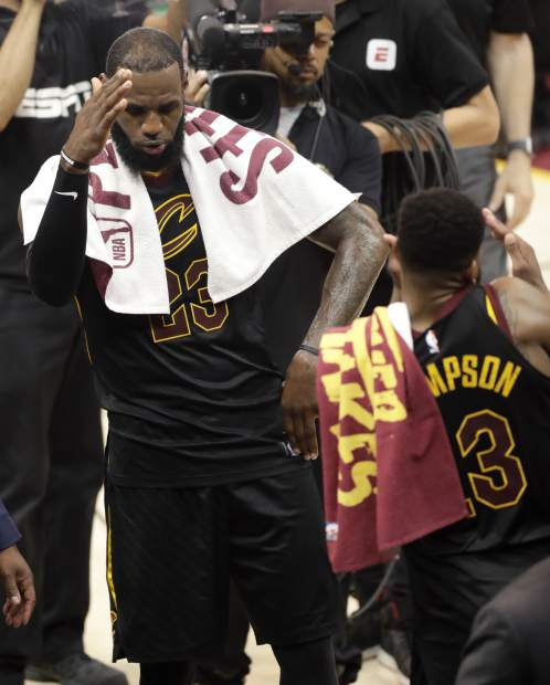 Cleveland Cavaliers' LeBron James (23) celebrates with Tristan Thompson after a 111-102 victory over the Boston Celtics in Game 4 of the NBA basketball Eastern Conference finals, Monday, May 21, 2018, in Cleveland. (AP Photo/Tony Dejak)