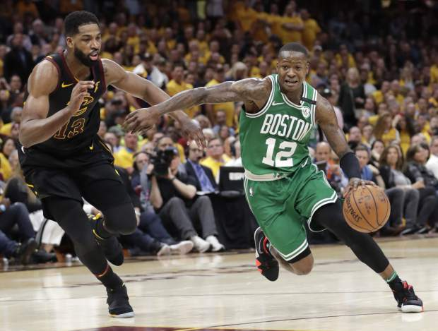 Boston Celtics' Terry Rozier (12) drives on Cleveland Cavaliers' Tristan Thompson (13) in the second half of Game 4 of the NBA basketball Eastern Conference finals, Monday, May 21, 2018, in Cleveland. (AP Photo/Tony Dejak)