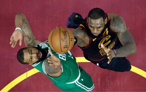 Cleveland Cavaliers' LeBron James, right, drives to the basket against Boston Celtics' Marcus Morris in the second half of Game 4 of the NBA basketball Eastern Conference finals, Monday, May 21, 2018, in Cleveland. The Cavaliers won 111-102. (AP Photo/Tony Dejak)