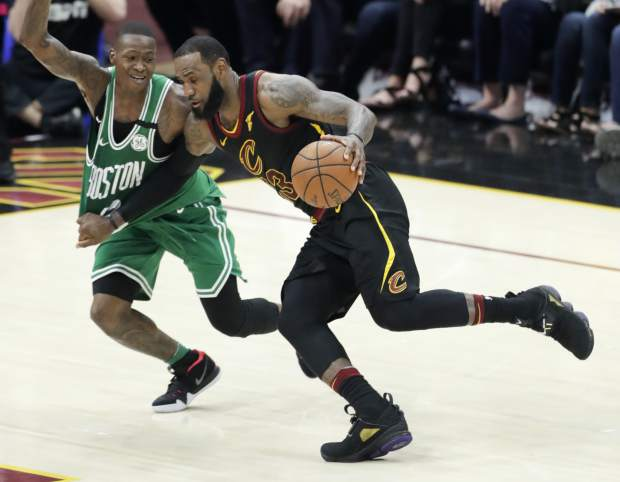 Cleveland Cavaliers' LeBron James drives on Boston Celtics' Terry Rozier in the first half of Game 4 of the NBA basketball Eastern Conference finals, Monday, May 21, 2018, in Cleveland. (AP Photo/Tony Dejak)