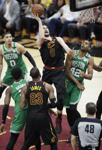 Cleveland Cavaliers' Kevin Love (0) puts up a shot against the Boston Celtics in the second half of Game 4 of the NBA basketball Eastern Conference finals, Monday, May 21, 2018, in Cleveland. The Cavaliers defeated the Celtics 111-102. (AP Photo/Tony Dejak)