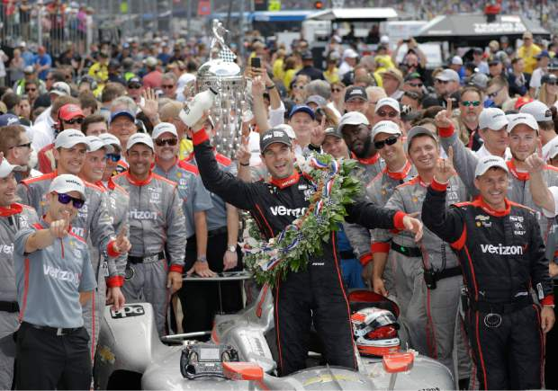 Will Power, of Australia, celebrates after winning the Indianapolis 500 auto race at Indianapolis Motor Speedway, in Indianapolis Sunday, May 27, 2018. (AP Photo/Darron Cummings)