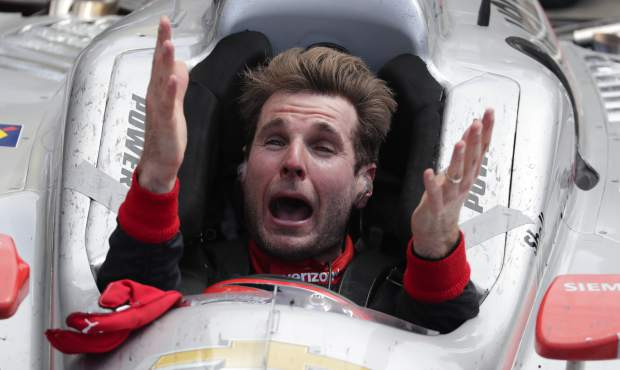 Will Power, of Australia, celebrates after winning the Indianapolis 500 auto race at Indianapolis Motor Speedway in Indianapolis, Sunday, May 27, 2018. (AP Photo/Michael Conroy)