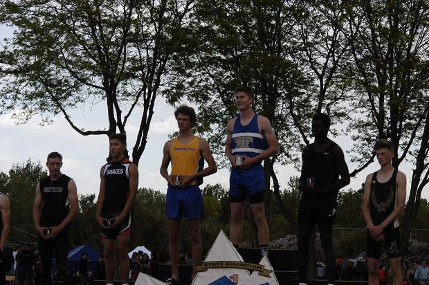 Roaring Fork seniors Justin Thompson and Jasper Germain stand 1-2 on the podium for the 3A triple jump state championship. Thompson set a new personal mark, jumping 45-11.75 feet, while Germain also set a new personal mark with a distance of 45-4.50.
