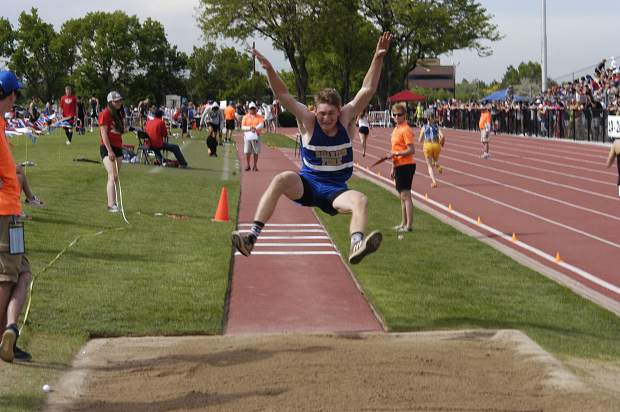 Roaring Fork senior Justin Thompson leaps through the air during Thursday's 3A triple jump at JeffCo Stadium in Lakewood.