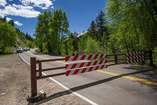 Colorado Department of Transportation vehicles descend on Independence Pass Road on Thursday to officially open the gate at noon for car traffic for the summer season.