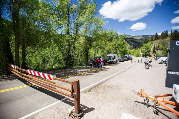 Cars and people line up at the Independence Pass gate in Aspen waiting for the Colorado Department of Transportation workers to come down and unlock it at noon on Thursday for the summer season.