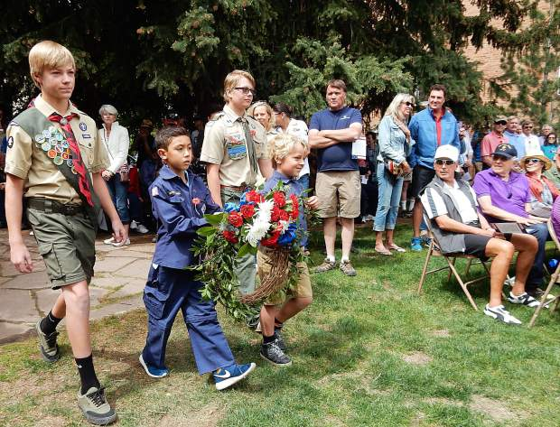 Members of the local troops of the Scouts undertake the Laying of the Memorial Wreath at Aspen's Memorial Day Observance on Monday.