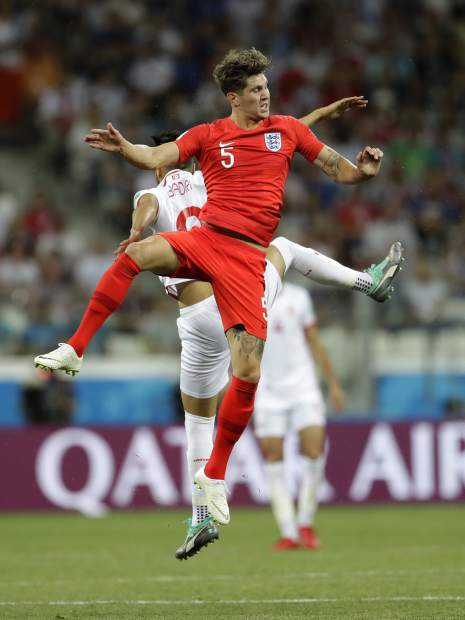 England's John Stones, foreground, and Tunisia's Anice Badri, jump for the ball during the group G match between Tunisia and England at the 2018 soccer World Cup in the Volgograd Arena in Volgograd, Russia, Monday, June 18, 2018. (AP Photo/Sergei Grits)
