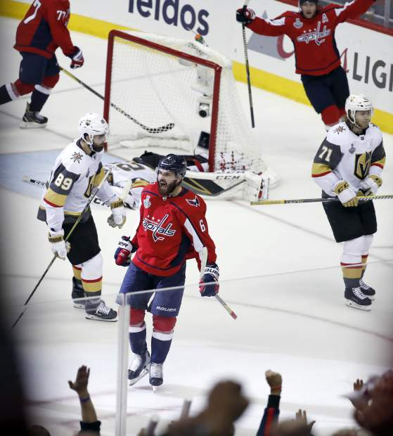 Washington Capitals defenseman Michal Kempny (6), of the Czech Republic, celebrates his goal against the Vegas Golden Knights during the third period in Game 4 of the NHL hockey Stanley Cup Final, Monday, June 4, 2018, in Washington. (AP Photo/Pablo Martinez Monsivais)