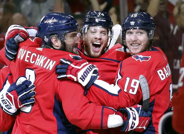 Washington Capitals defenseman John Carlson, center, celebrates his goal against the Vegas Golden Knights with Alex Ovechkin, left, of Russia, and Nicklas Backstrom, right, of Sweden, during the second period in Game 4 of the NHL hockey Stanley Cup Final, Monday, in Washington.