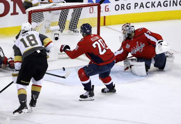 A shot by Vegas Golden Knights forward James Neal (18) misses an open net as Washington Capitals goaltender Braden Holtby, right, defends during the first period in Game 4 of the NHL hockey Stanley Cup Final, Monday, June 4, 2018, in Washington. (AP Photo/Pablo Martinez Monsivais)