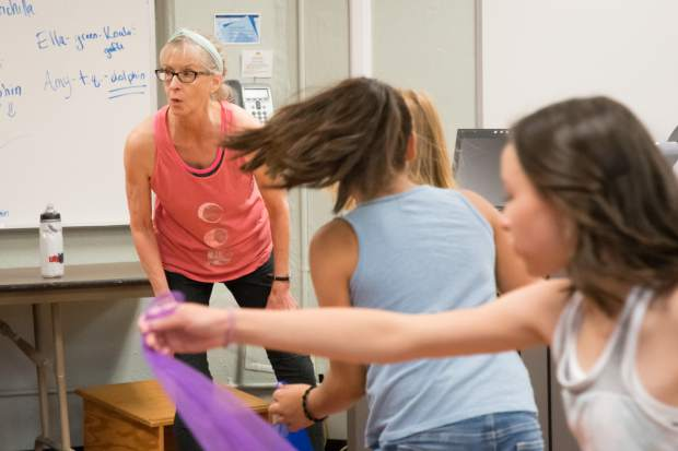 Maurine Taufer watches the student designed dance routine during her class last Wednesday.