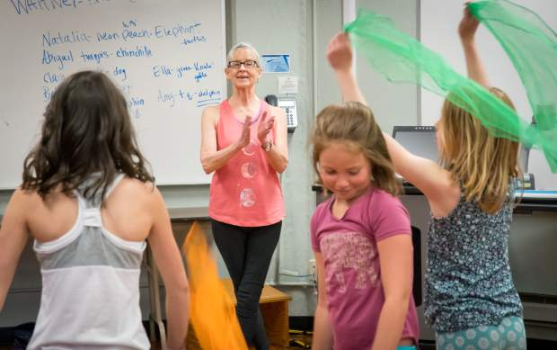 Maurine Taufer watches the student choreographed dance routine during her class last Wednesday.