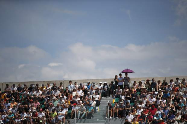 Spectators watch the match between Spain's Rafael Nadal and Germany's Maximilian Marterer in the fourth round of the French Open tennis tournament at the Roland Garros stadium in Paris, France, Monday, June 4, 2018. (AP Photo/Christophe Ena)