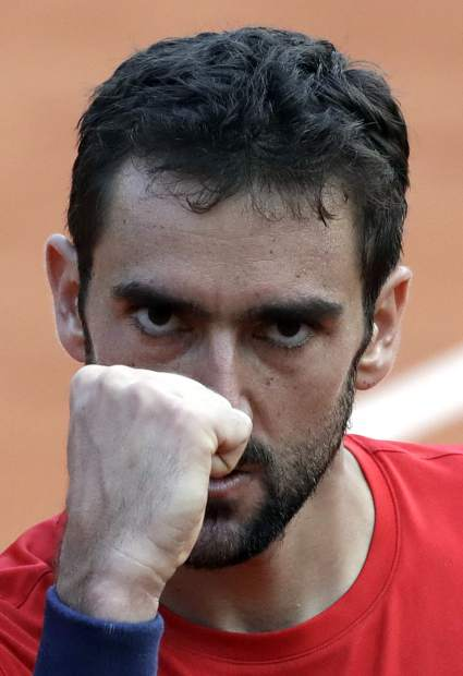 Croatia's Marin Cilic celebrates winning the fourth set as he plays Italy's Fabio Fognini during their fourth match of the French Open tennis tournament at the Roland Garros stadium, Monday, June 4, 2018 in Paris. (AP Photo/Alessandra Tarantino)