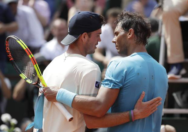 Spain's Rafael Nadal, right, hugs Germany's Maximilian Marterer after their fourth match of the French Open tennis tournament at the Roland Garros stadium, Monday, June 4, 2018 in Paris. Nadal won 6-3, 6-2, 7-6 (4). (AP Photo/Alessandra Tarantino)