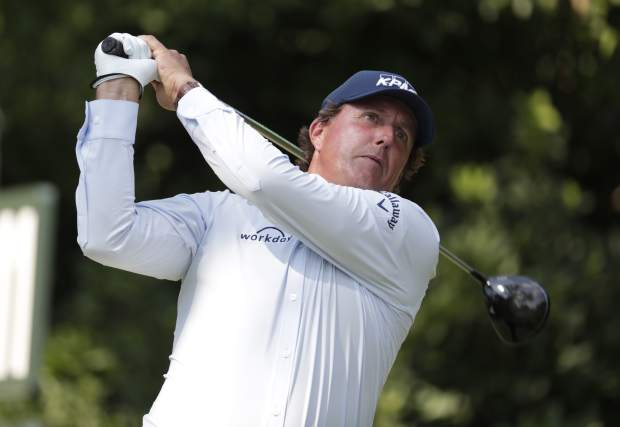 This photo taken May 10, 2018, shows Phil Mickelson hitting from the 11th tee during the first round of the Players Championship golf tournament in Ponte Vedra Beach, Fla. Mickelson doesn't need to be reminded that this is his 27th appearance in the U.S. Open, more than any of the 156 players at Shinnecock Hills. He wouldn't want to be reminded that 65 players, including the last four major champions, were not even born when Mickelson was low amateur in his first U.S. Open in 1990 at Medinah.