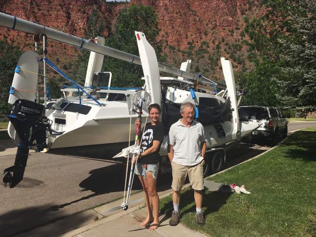 Kelsey Bohanon, left, and father Bo of Glenwood Springs show off the bicycle pedal device they are using this week in part to power their trimaran sailboat in the Race2Alaska, thanks to help from Carbondale bike wizard Aaron Taylor.