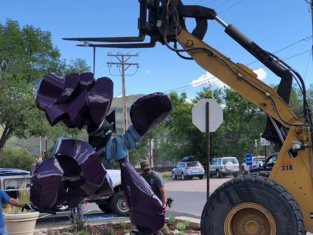 Town of Carbondale crews work to install Alex Barrett's piece Uppercut near the Carbondale Community Center on Wednesday.